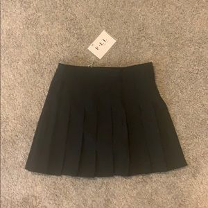 Pleated black skirt with built in shorts